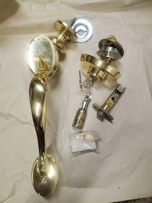 Kwikset brass front door handle wit smartkey lock for Sale in Seal Beach, CA