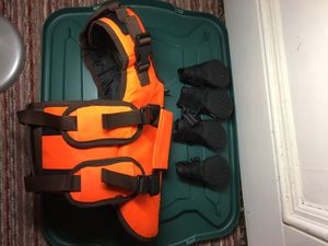 Dog jacket and shoes size medium for Sale in Everett, WA