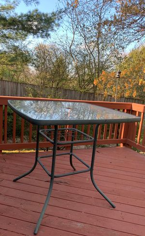 Glass outdoor table with 4 chairs for Sale in Alexandria, VA