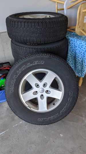 Jeep Wrangler rims and tires for Sale in Denver, CO