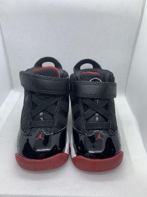 Black and red Jordan's size 6c for Sale in Linden, NJ