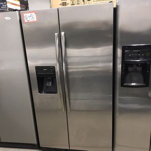 AMANA STAINLESS STEEL SIDE BY SIDE FRIDGE IN EXCELLENT CONDITION for Sale in Baltimore, MD