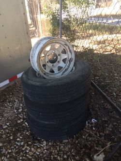 America's trailer tire and rim set of 3 with one rim for Sale in San Antonio,  TX