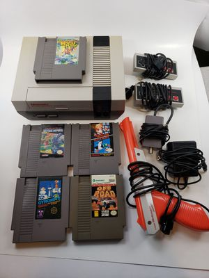 Original NES (Nintendo) with six games, 2 controllers, cords, and zapper. Works great. for Sale in Thompson's Station, TN