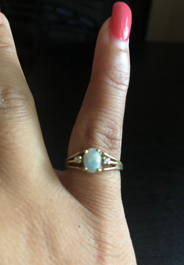 Gold Opal with tiny diamonds ring