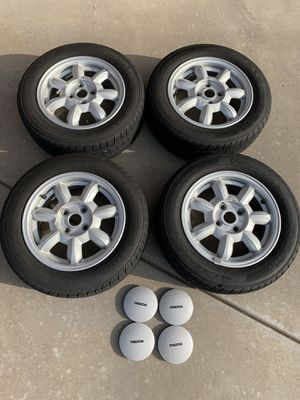 OEM daisy wheels from a 1992 Mazda Miata for Sale in Wichita, KS