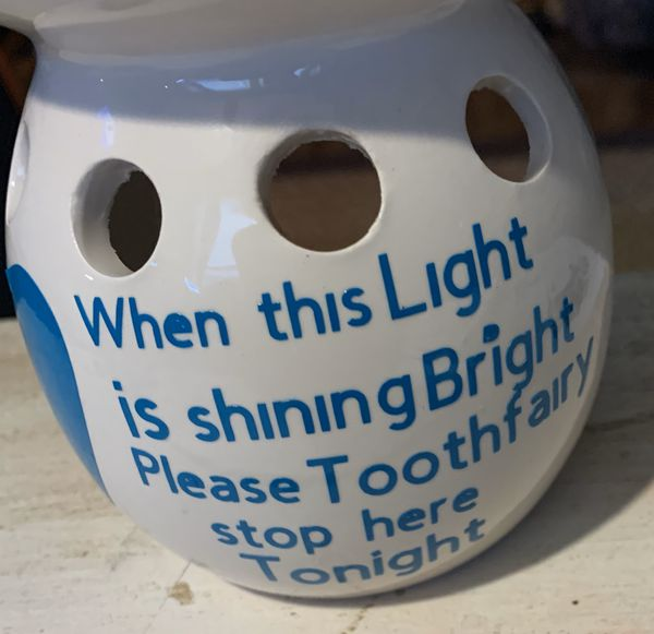 Tooth fairy lighted holder