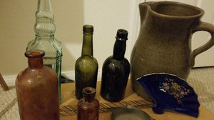 Variety of antique bottles, clay jug, and cast iron ash tray for Sale in Los Angeles, CA