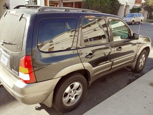 👍😄2005 Mazda Tribute. Needs Mechanic. CLEAN TITLE. Pink slip in hand. Registered ok. Cheap! for Sale in Los Angeles, CA