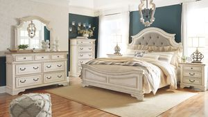 Realyn - Two-tone - 7 Pc. - Dresser, Mirror, Queen UPH Panel Bed & 2 Nightstands for Sale in Naples, FL