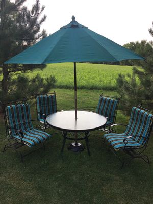 Patio set 11 pieces table for chairs market umbrella With stand and for a new reversible cushions made of metal very strong and chairs have a little for Sale in Varna, IL