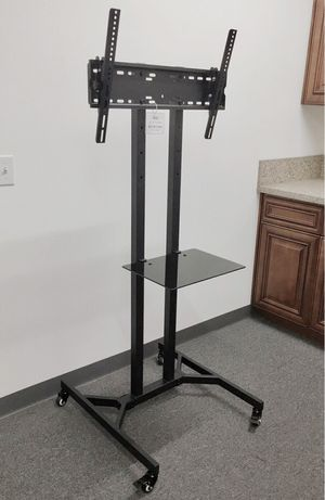 "New in box 28"" depth x 26"" wide x 65"" tall for 32 to 65 inch tv sizes television heavy duty stand with locking wheels and DVD shelf for Sale in Whittier, CA"