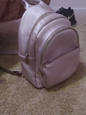 Metallic pink purse backpack for Sale in Lawrenceville, GA