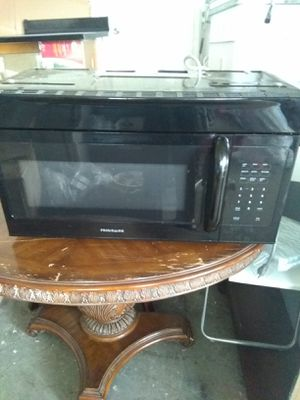 Combo Frigidaire Black refrigerator and Electric Stove and microwave and dishwasher all working perfect condition$450 for Sale in Boca Raton, FL