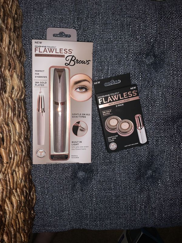Finishing Touch Flawless Brow Hair Remover. Comes With a Free box of replacement heads.