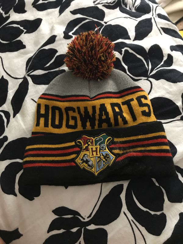 Slytherin Harry Potter back pack from the Harry Potter collectible site retail price 50 with hog warts hat and some Harry Potter toys