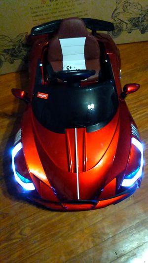 KIDS ELECTRIC CAR WITH REMOTE CONTROL, BLUETOOTH &THIS CAR HAVE A ROCK THE BABAY TO SLEEP MODE GOING FAST!!! for Sale in Baytown, TX