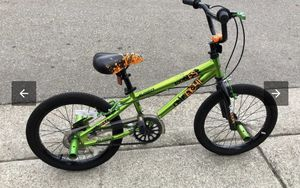 BIKE: boys bike by Avigo 1800 18 inch bike with pegs & training wheels for Sale in Alexandria, VA