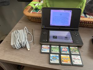 Nintendo DSi Lite with 9 games!! Case included for Sale in South Hill, WA