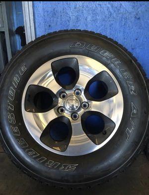 Tires Bridgestone 265/70r18 with wheels for Sale in Orlando, FL