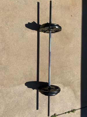 Weight bar 1in w/ 70lbs for Sale in Denver, CO