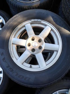 """Jeep wheels and tires set of 4 factory oem 17"""" for Sale in Orlando, FL"""