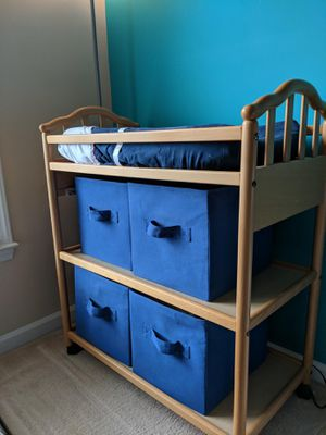 Changing table with baskets for Sale in Huntersville, NC