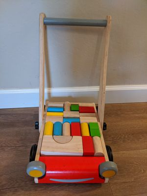 Plan toys baby walker for Sale in Oakland, CA