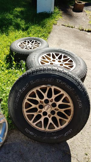 Set of four Jeep Wheels and Tires Tires are weathered for Sale in Kalama, WA
