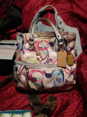 Coach purse w 5 charms for Sale in Mead, WA