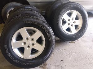 Jeep wrangler wheels and tires 17 inch takeoffs from a 2016 Jeep Wrangler 5 wheels and tires for Sale in Pompano Beach, FL