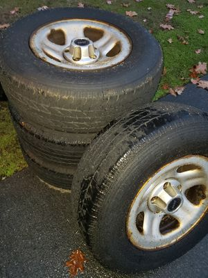 Jeep Wrangler Jeep Cherokee wheels and tires Centercap included 225 75 15 for Sale in Puyallup, WA