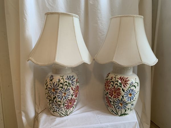 Pair of flower based lamps with shades