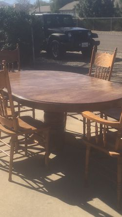 Oak Table With leaf Two Arm Chairs And Four Regular Chairs for Sale in Riverside,  CA
