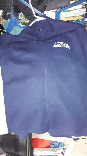 Seahawks jacket 2 XL vikings jersy 30 cowboys jersy 30 all been worn a couple x almost brand new for Sale in Butte, MT
