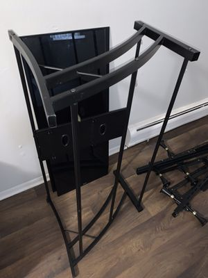 2 for $100: adjustable bed frame & Glass tv stand for Sale in Warren, MI