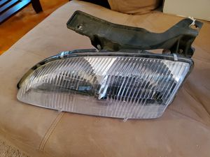 GM 95-99 Cavalier Headlight with Bracket LH 16518391 for Sale in Palmdale, CA