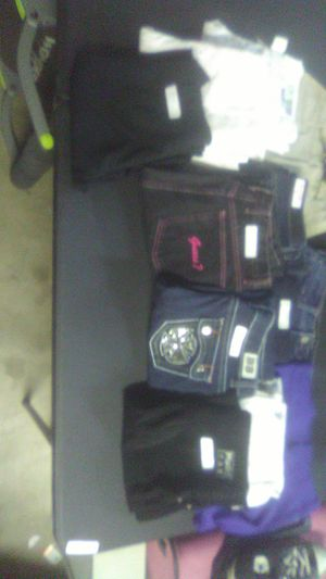 12 pairs of women's pants and shorts for Sale in Avondale, AZ
