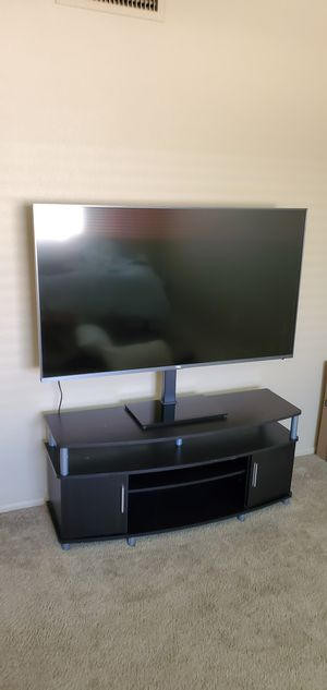 4k UHD TCL 55 inch smart TV with stand and entertainment stand for Sale in Scottsdale, AZ