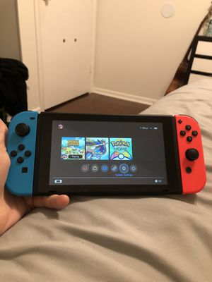 Nintendo Switch Console with Neon Blue & Red Joy-Con Sold Out NIB + Animal Crossing and Pokemon sword for Sale in Plantation, FL