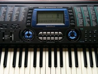 Radio Shack MD-1210 MIDI Custom Tone synthesizer Keyboard With Metal Stand for Sale in Manassas,  VA