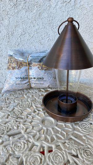 Bird feeder and bird food for Sale in Rialto, CA