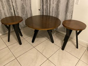 Round wood + black coffee tables and end table for Sale in Los Angeles, CA
