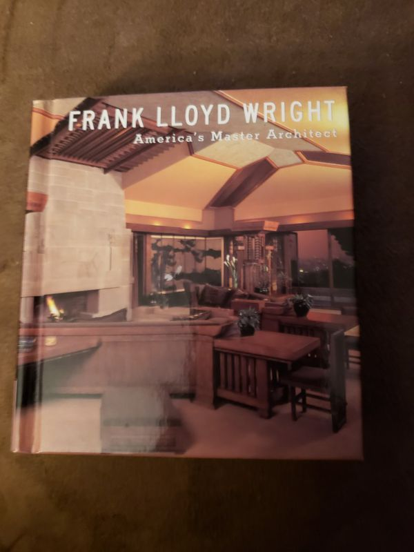 Hand held Frank lloyd Wright architectural book
