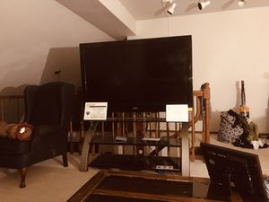 60 inch Sanyo TV with Glass Stand 400.00 for Sale in Florissant, MO