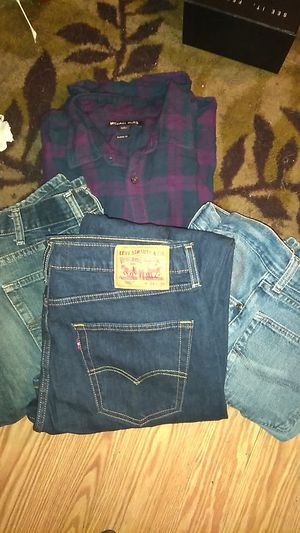Lot of 4: new levi jeans 34x30 2 used Lee jeans Michael Kors L longsleeve for Sale in Des Plaines, IL