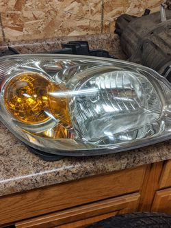 Chevy Cobalt Head Light Assembly. for Sale in Canton,  IL