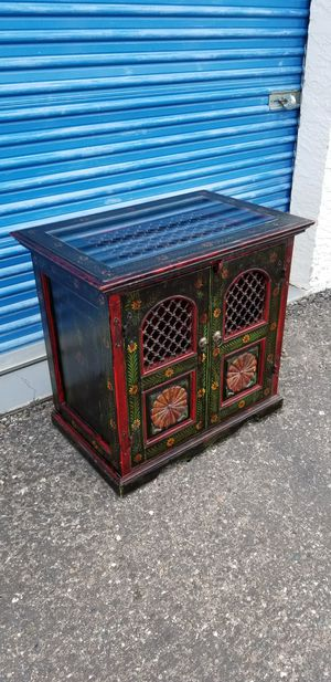 Small painted accent chest. Could also be used as a large nightstand. Thick glass top with metal inserts.. for Sale in Phoenix, AZ