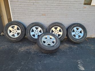 Jeep wrangler rims and tires for Sale in Bellwood,  IL