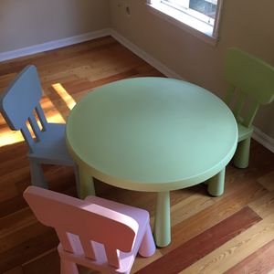 Ikea kids play table with three chairs for Sale in Alexandria, VA